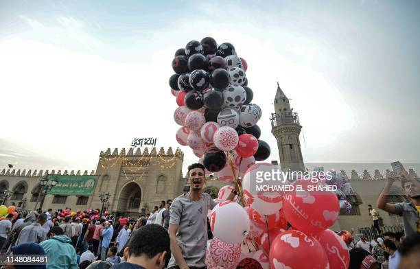Muslims celebrate the Eid alFitr holiday marking the end of the holy fasting month of Ramadan after the morning prayer at Old Cairo's historic Amr...
