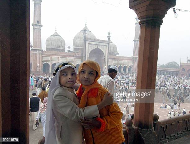 Muslims children greets each other during prayers at the Jama Masjid mosque India's biggest to celebrate EidAlAzha in New Delhi 21 January 2005...