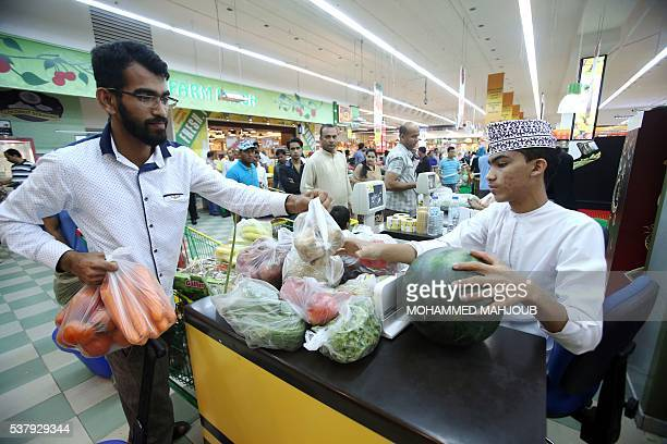 Muslims do some shopping at a supermarket in the Omani capital Muscat on June 3 as the faithful prepare for the start of the Muslim holy fasting...