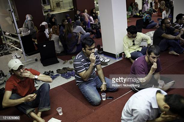 Muslims eat dates when first breaking their daylong Ramadan fast August 2 2011 at the New York University's Islamic Center in the Manhattan borough...