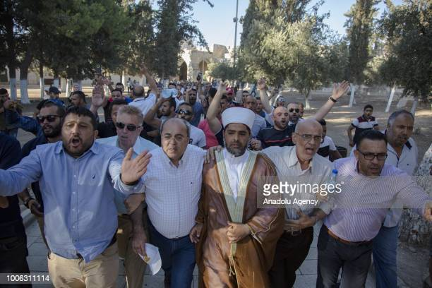 Muslims enter the AlAqsa Mosque as it is reopened after it was closed by Israeli forces following the clashes between Israeli forces and worshipers...