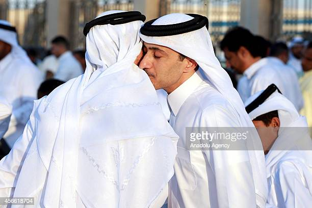 Muslims exchange greetings after performing Eid alAdha prayer at the Ali Bin Ali Mosque in Doha Qatar on the first day of Eid alAdha October 42014...