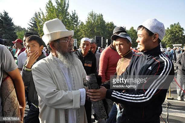 Muslims exchange greetings on the second day of Eid alFitr after Eid alFitr prayer in Bishkek Kyrgyzstan on 29 July 2014