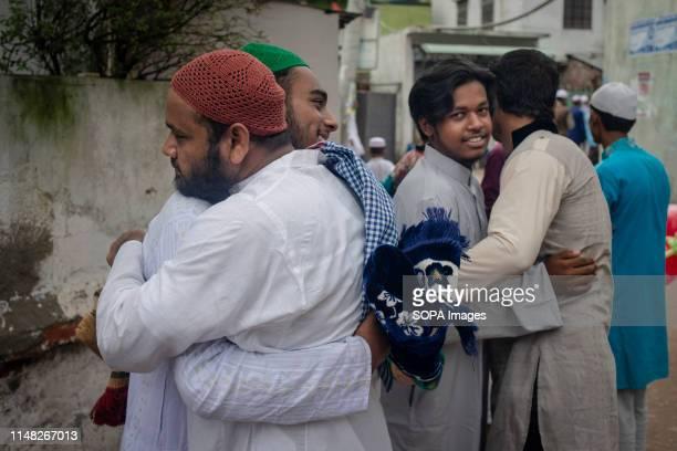 Muslims exchanging Eid greetings hugging at the street just after attending EidUl_fitr salah prayer Muslims participating in EidUlFitr salah prayer...