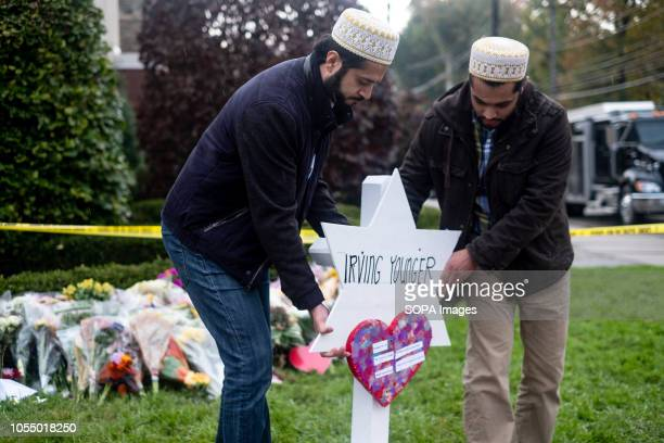 Muslims from Hydrabad seen placing a temporary grave for Irving Younger at the makeshift memorial After the tragic shooting in Pittsburgh PA at the...