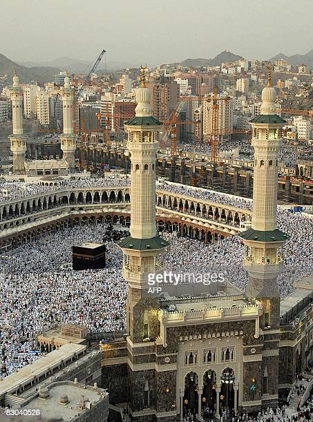 Muslims gather around the Kaaba as they pray at the alHaram Grand Mosque in the Saudi holy city of Mecca before breaking their fast at dusk on...