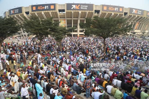 Muslims gather at the area outside the Stade des Martyrs to perform the Eid Al Adha prayer in Kinshasa, Democratic Republic of Congo on August 11,...