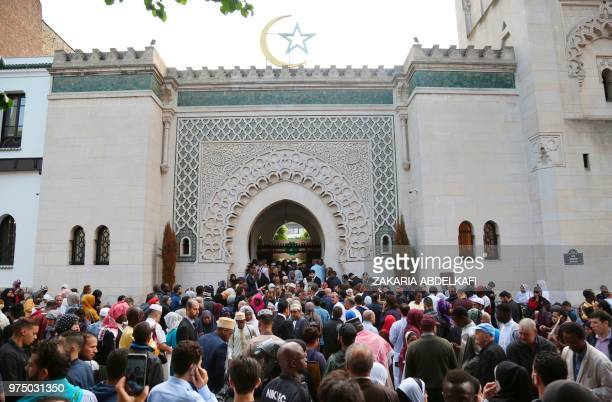 Muslims gather at the Grande Mosquee de Paris in Paris at the start of the Eid alFitr holiday which marks the end of Ramadan on June 15 2018