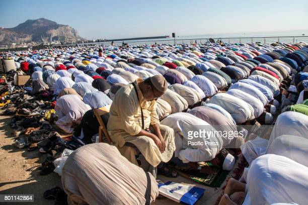 Muslims gather for special prayers at the Foro Italico to celebrate Eid alFitr in Palermo Eid alFitr marks the end of Ramadan the Islamic holy month...