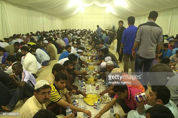 Muslims gather in iftar tents pitched by Dubai government to break their fast on the first day of holy mont Ramadan in Dubai United Arab Emirates on...