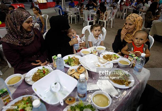 Muslims gather in iftar tents to break their fast on the first day of holy month Ramadan in Beirut Lebanon on June 292014 Islam's holy month of...