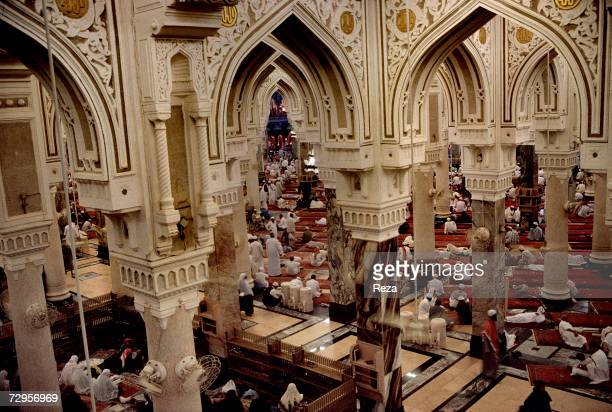 Muslims gather on prayer rugs inside the Masjid AlHaram mosque location of the Kaaba Islam's most sacred sanctuary and pilgrimage shrine on Eid...
