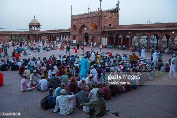 Muslims gather to have first Iftar of the holy month of Ramadan at Jama Masjid in the walled city in Old Delhi India on May 07 2019 Muslims in the...