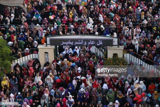 Muslims gather to perform Eid alFitr prayer at Abu Bakr alSiddiq Mosque in Cairo Egypt on June 25 2017 Eid alFitr is a religious holiday celebrated...