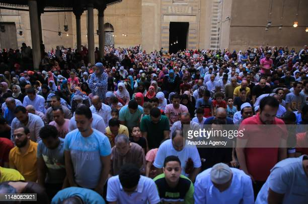 Muslims gather to perform Eid alFitr prayer at MosqueMadrassa of Sultan Hassan in Cairo Egypt on June 5 2019 Eid alFitr is a religious holiday...
