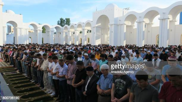 Muslims gather to perform the Eid alFitr prayer at NurAstana Mosque in Astana Kazakhstan on June 25 2017 Eid alFitr is a religious holiday celebrated...
