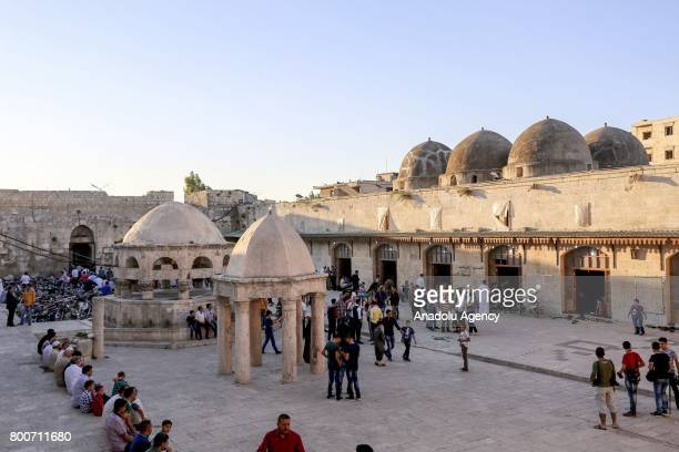 Muslims gather to perform the Eid alFitr prayer at Umayyad Mosque in Idlib Syria on June 25 2017 Eid alFitr is a religious holiday celebrated by...