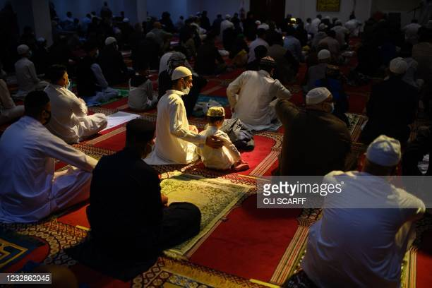 Muslims gather to perform the Eid Al-Fitr prayer, which marks the end of the holy month of Ramadan, at Bradford Central Mosque in Bradford, northern...