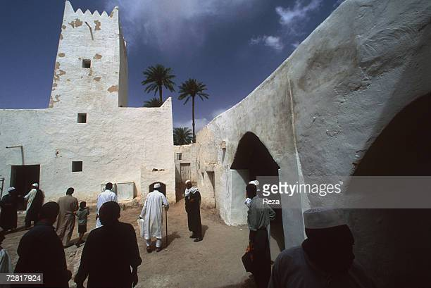 Muslims go to the mosque in the central square April 2000 in Ghadames Libya