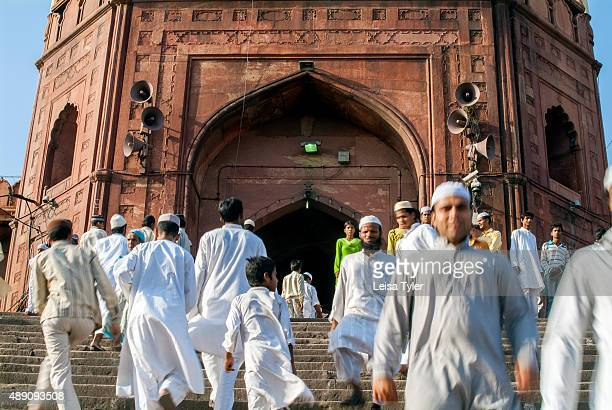 Muslims going for Friday prayer at the Jama Masjid in Delhi built between 1644 and 1656 by Mughal emperor Shah Jahan
