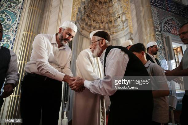 Muslims greet each other after performing the Eid Al Adha prayer at Kocatepe Mosque in Ankara Turkey on August 11 2019 Muslims worldwide celebrate...