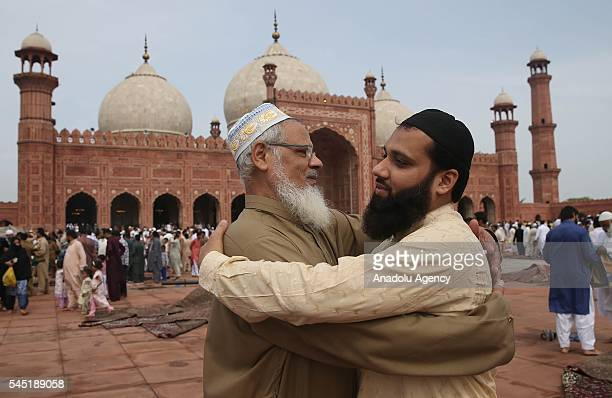 Muslims greet each other after they performed Eid alFitr prayer during the Eid alFitr holiday at Badshahi Mosque in Lahore Pakistan on July 06 2016...