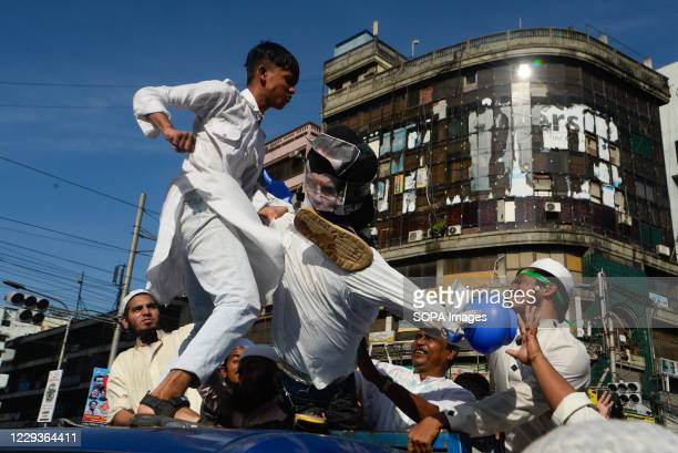 Muslims hit the effigy depicting the French president Emmanuel Macron after Friday prayer as they take part during the demonstration. Protest calling...