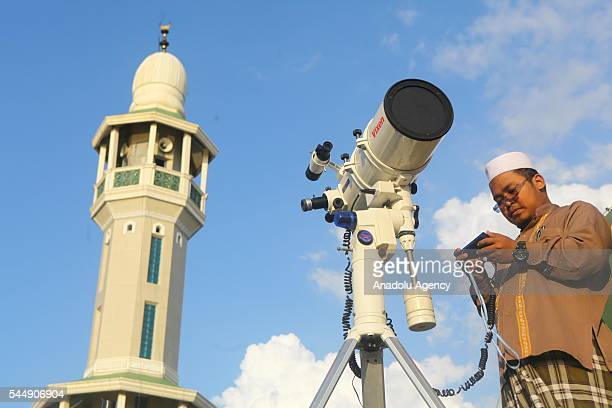 Muslims hold a 'Rukyatul Hilal' to see the new crescent moon that determines the end of Ramadan in Jakarta Indonesia on July 04 2016 This activity to...