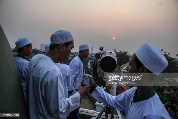 Muslims hold a 'Rukyatul Hilal' to see the new crescent moon that determines the start of Ramadan in Jakarta Indonesia on May 26 2017 This activity...