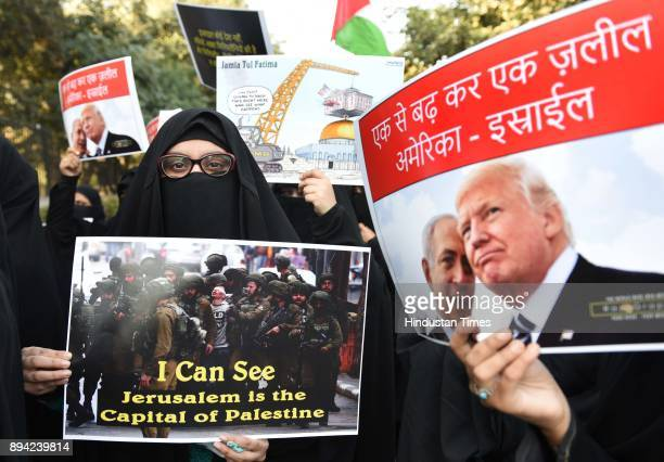 Muslims hold placards during a protest rally following US President Donald Trump's decision to officially recognise Jerusalem as the Israeli capital...