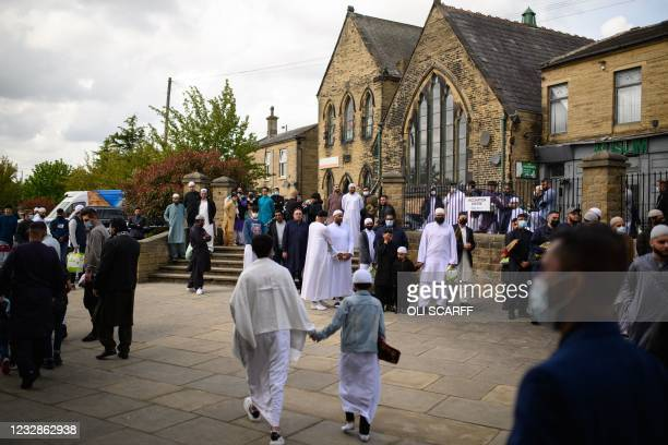 Muslims leave after the Eid Al-Fitr prayer, which marks the end of the holy month of Ramadan, at Bradford Central Mosque in Bradford, northern...