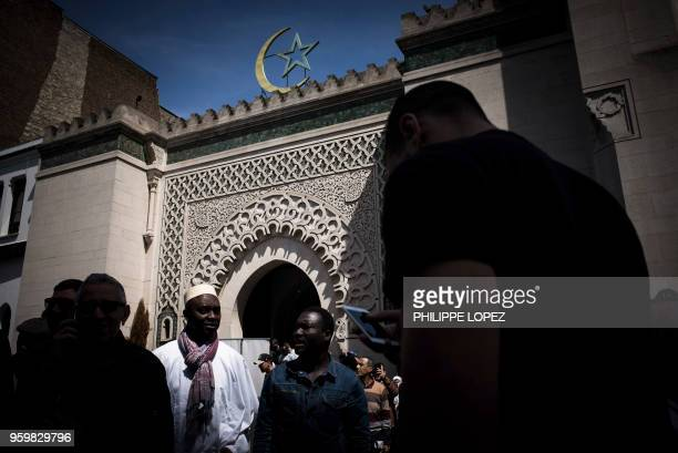 Muslims leave the Grande Mosquee de Paris in Paris on May 18 2018 after the first Friday prayers of the holy month of Ramadan