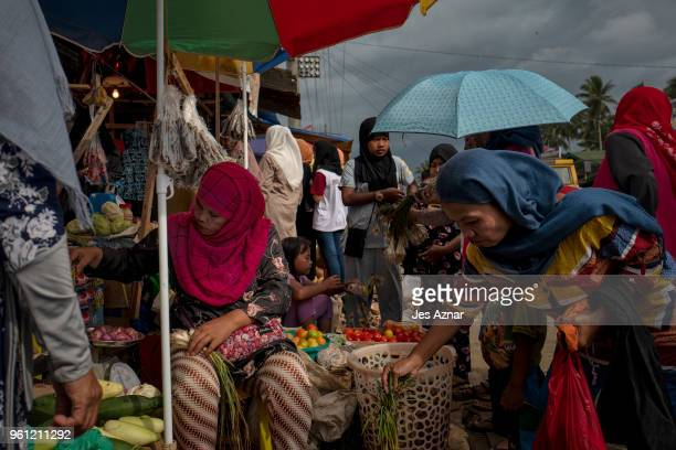 Muslims living near Marawi buy food items to stock as the start of Ramadan nears on May 15 2018 in Saguiaran Philippines With their homes destroyed...