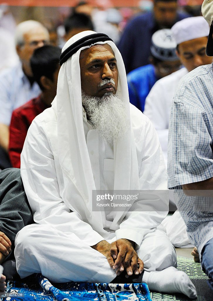 A Muslims man sits during a special Eid ul-Fitr morning prayer at the Los Angeles Convention Center on August 30, 2011 in Los Angeles, California. The three-day holiday, Eid ul-Fitr, marks the end of Ramadan, the Islamic month of fasting and begins after the sighting of a new crescent moon.