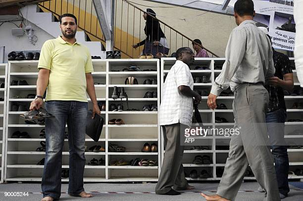 Muslims men take back their shoes at the end of the prayer in AnNour mosque on the first day of the holy fasting month of Ramadan in Mulhouse on...
