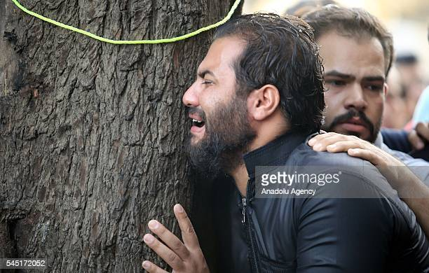 Muslims mourn after they performed Eid alFitr prayer during the Eid alFitr holiday at the street where recent terrorist attack happened in Bahdad...