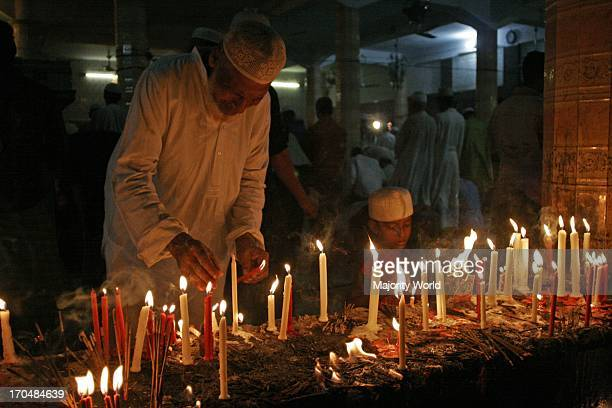 Muslims observes Lailat Ul Qadr An elderly man lights candles at a shrine while Muslims offering special prayers marking LailatUlQadar the...