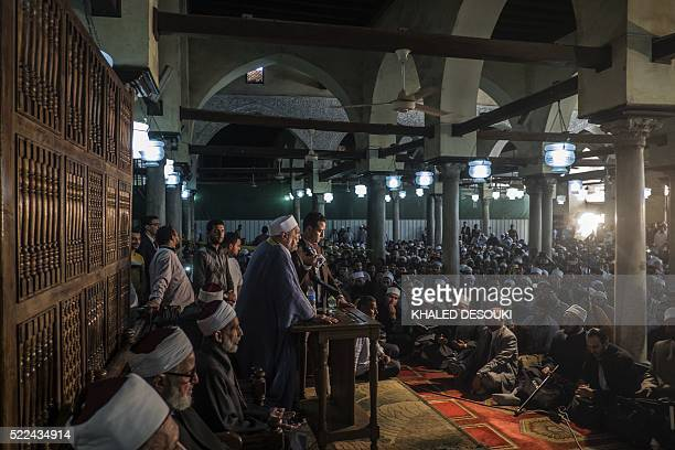 Muslims of different nationalities attend a hadith recitation session at the alAzhar mosque in Cairo on April 19 2016 The traditional practice that...