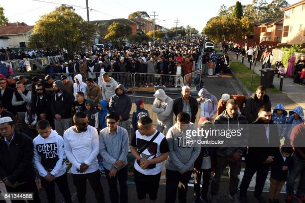 Muslims offer Eid alAdha prayers on the road outside the Lakemba mosque in Sydney on September 1 2017 Muslims living in Australia are celebrating Eid...