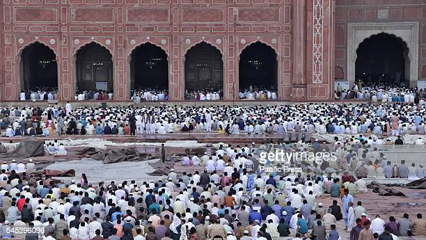 Muslims offer prayer despite the rain in celebration of the Eid alFitr congregational prayers at the historical Badshahi MosqueThe threeday festival...