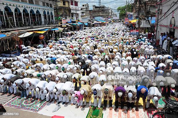 Muslims offer prayer for Gaza victims during Namaz E Alvida in front of Jama Masjid on the occasion of last friday of Ramzan month in Allahabad
