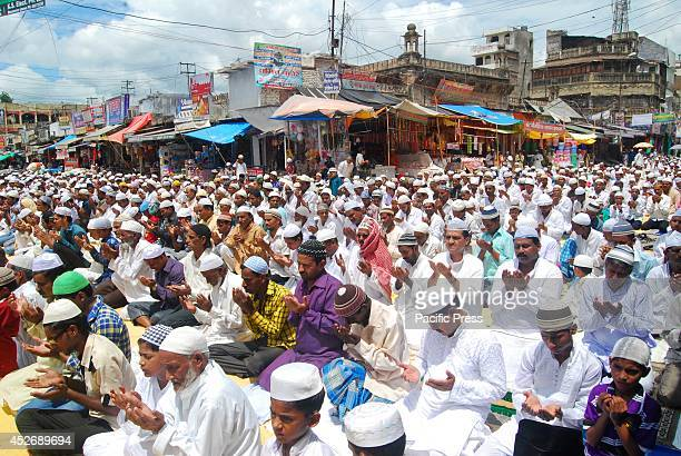Muslims offer prayer for Gaza victims during Namaz E Alvida on the occasion of last friday of Ramzan month in Allahabad