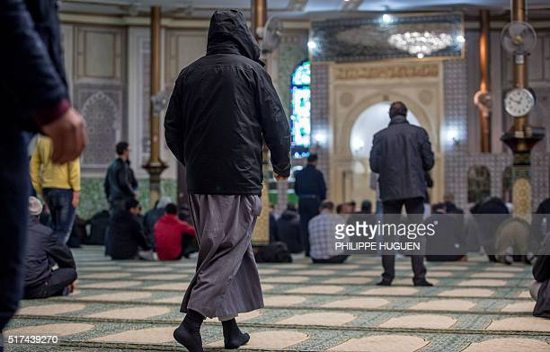 Muslims offer prayers at the Grand Mosque in Brussels on Match 25 as Muslims gathered for the first Friday prayers in the wake of the suicide attacks...