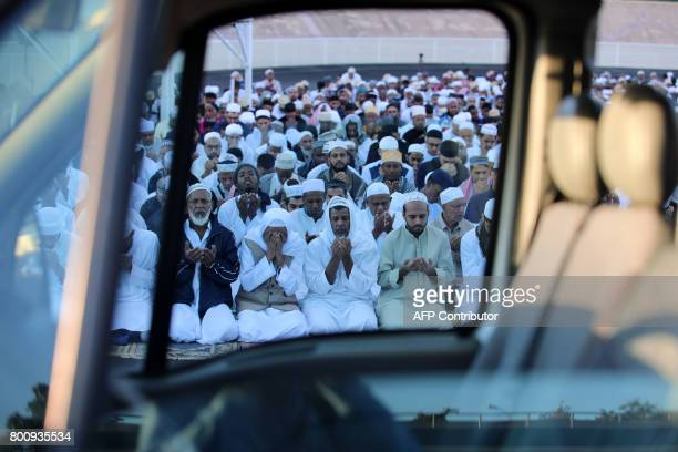 Muslims offer prayers during Eid alFitr at the velodrome de ChampFleuri in SaintDenis de la Reunion on the French Indian Ocean island of Reunion on...
