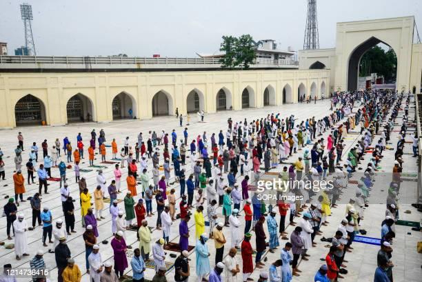 Muslims offer prayers on the last Friday of the Islamic holy fasting month of Ramadan at the Baitul Mokarrn National mosque amid Coronavirus crisis....