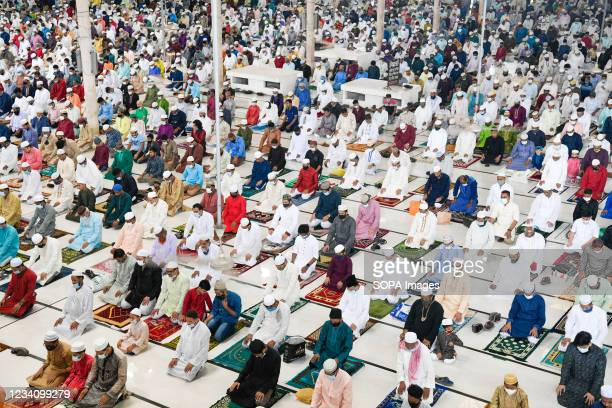 Muslims offer prayers to mark the start of the Muslim festival Eid al-Adha or the 'Festival of Sacrifice at Baitul Mukarram National Mosque in Dhaka.