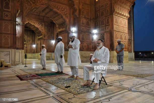 Muslims offer prayers while practicing social distancing inside closed Grand Mosque of Delhi Jama Masjid on the first day of Ramadan on 25 April 2020...