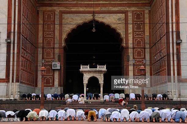 Muslims offering evening prayers on the first friday of holy fasting month of Ramadan at Jama Masjid on July 4 2014 in New Delhi India Muslims...