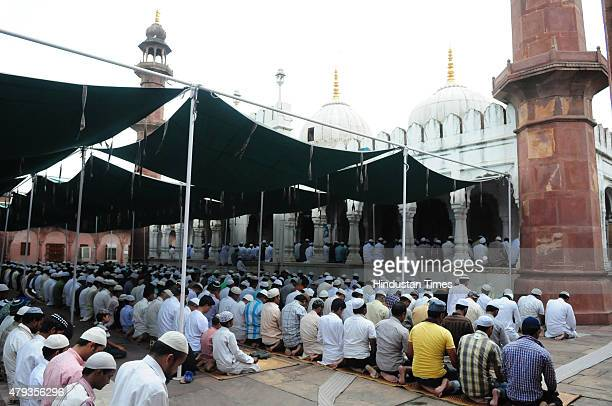 Muslims offering Friday Namaz at Moti Masjid during the ongoing holy month of Ramzan on July 3, 2015 in Bhopal, India. Muslims throughout the world...