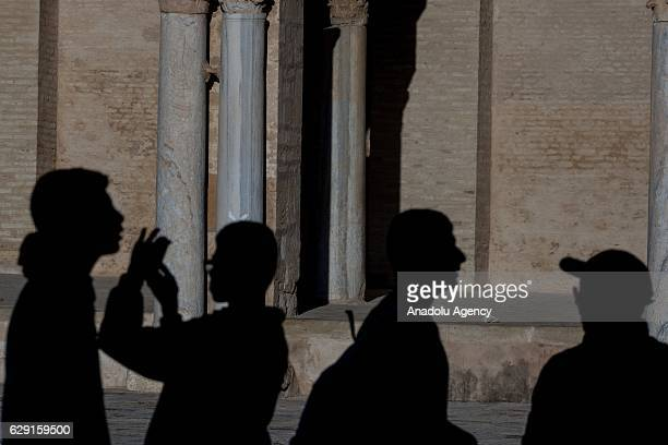 Muslims on their way to the Great Mosque of Kairouan also known as the Mosque of Uqba to attend the celebrations for Mawlid alNabi the birth...